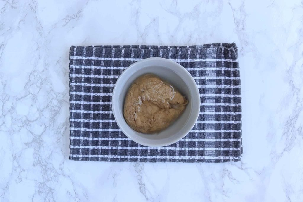 Seitan being rehydrated in a bowl