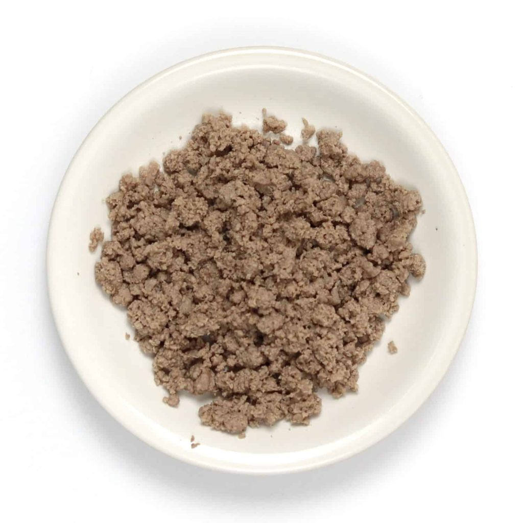 Ground beef on a small plate after blended in a food processor.