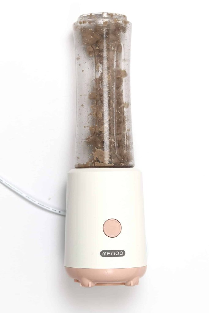 Ground beef in a blender after being processed