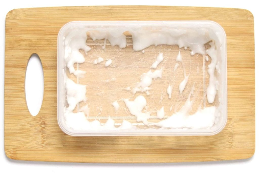 plastic container rubbed with a baking soda paste