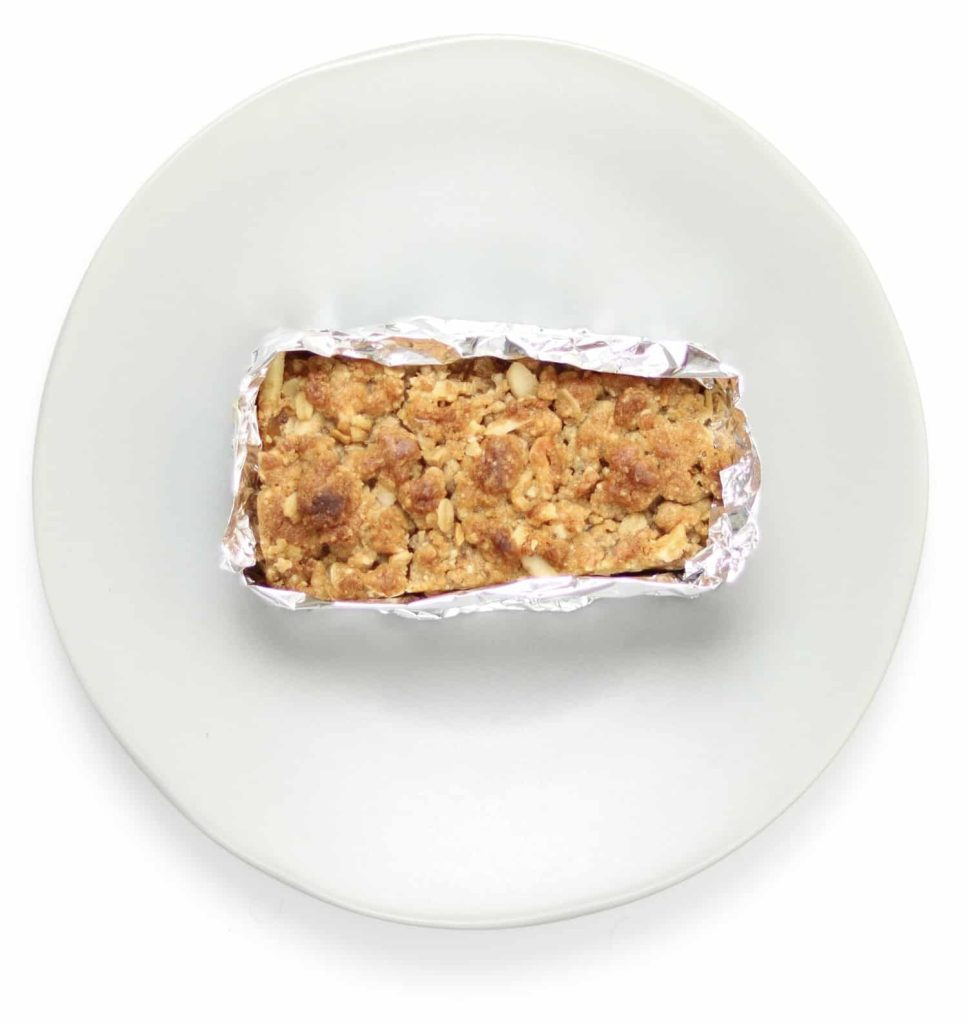Apple crisp wrapped in aluminum foil with top open