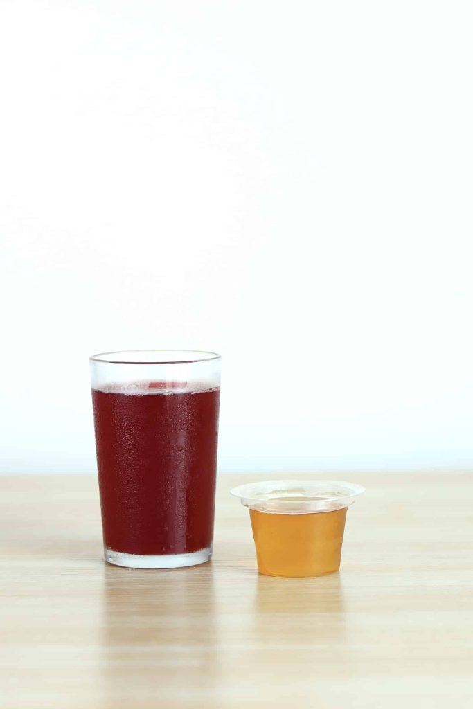 Cranberry juice and honey side by side