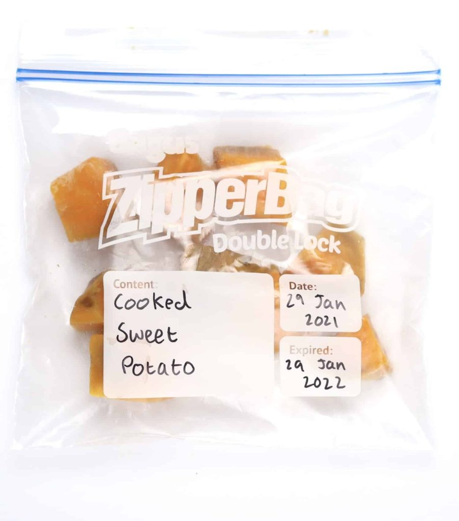 Cooked cut sweet potatoes ready for freezing in freezer bag